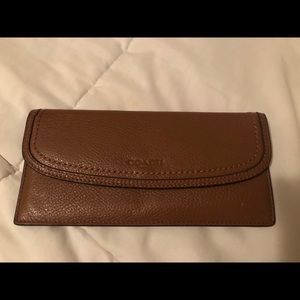 Coach wallet with four card department.